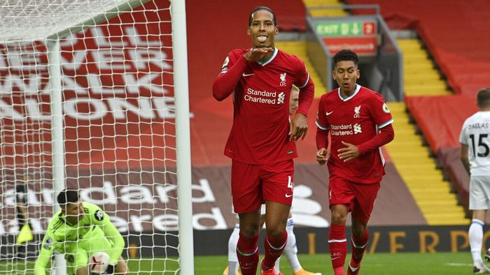 Liverpools Virgil van Dijk, center, celebrates after he scored his sides second goal during the English Premier League soccer match between Liverpool and Leeds United, at the Anfield stadium, in Liverpool, Saturday, Sept. 12, 2020. (Paul Ellis, Pool via AP)