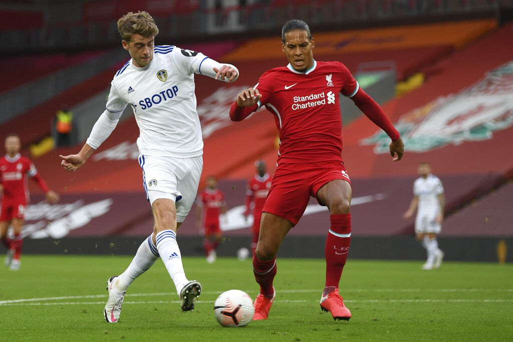Leeds United's Patrick Bamford, left, scores his side's second goal during the English Premier League soccer match between Liverpool and Leeds United, at the Anfield stadium, in Liverpool, Saturday, Sept. 12, 2020. (Shaun Botterill, Pool via AP)