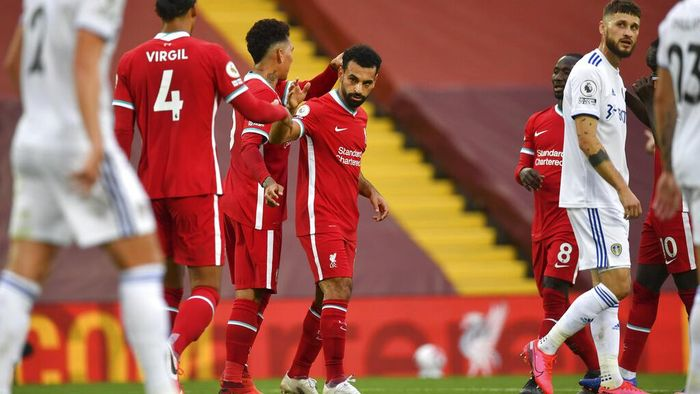 Liverpools Mohamed Salah, center, celebrates with his teammates after he scored his sides third goal during the English Premier League soccer match between Liverpool and Leeds United, at the Anfield stadium, in Liverpool, Saturday, Sept. 12, 2020. (Paul Ellis, Pool via AP)
