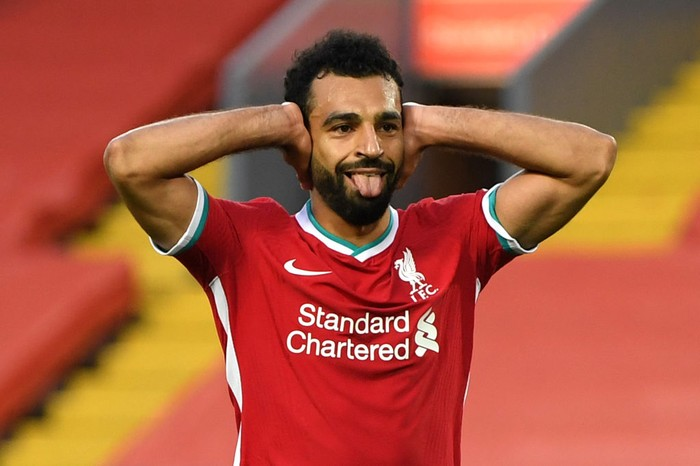 LIVERPOOL, ENGLAND - SEPTEMBER 12: Mohamed Salah of Liverpool celebrates after scoring his teams fourth goal during the Premier League match between Liverpool and Leeds United at Anfield on September 12, 2020 in Liverpool, England. (Photo by Shaun Botterill/Getty Images)