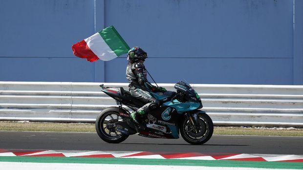 MotoGP rider Franco Morbidelli of Italy celebrates after winning the San Marino Motorcycle Grand Prix at the Misano circuit in Misano Adriatico, Italy, Sunday, Sept. 13, 2020. (AP Photo/Antonio Calanni)