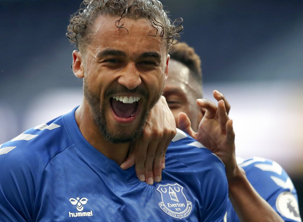 Everton's Dominic Calvert-Lewin, front, celebrates with teammates after scoring his side's opening goal during the English Premier League soccer match between Tottenham Hotspur and Everton at the Tottenham Hotspur Stadium in London, Sunday, Sept. 13, 2020. (Alex Pantling/Pool via AP)