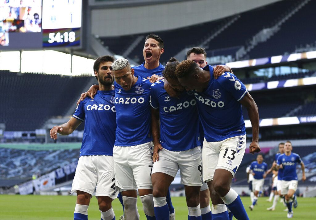 Everton's Dominic Calvert-Lewin, centre, celebrates with teammates after scoring his side's opening goal during the English Premier League soccer match between Tottenham Hotspur and Everton at the Tottenham Hotspur Stadium in London, Sunday, Sept. 13, 2020. (Alex Pantling/Pool via AP)