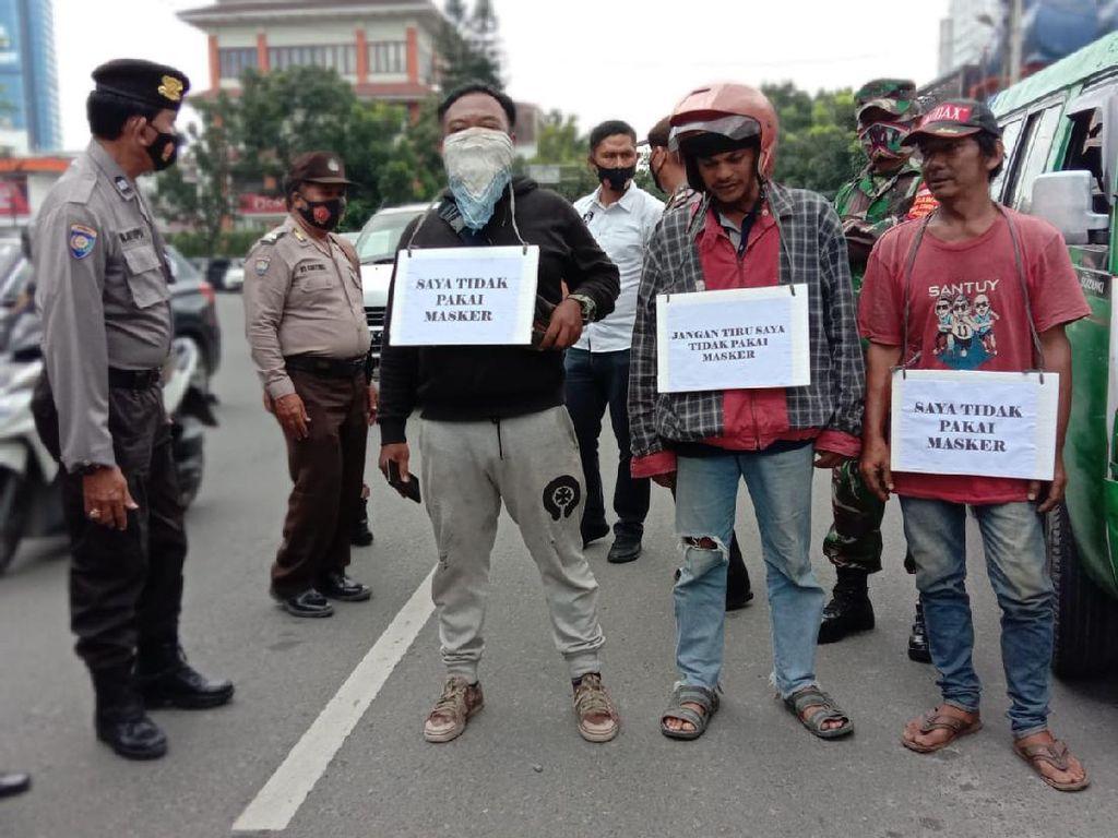 Sanksi Menyanyi dan Sita KTP Bagi Warga Tak Bermasker di Medan