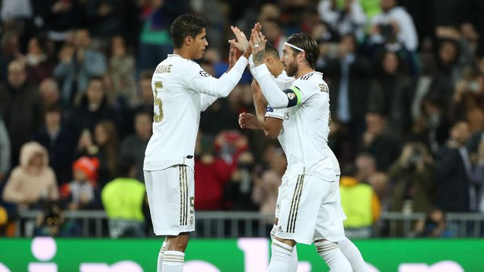MADRID, SPAIN - NOVEMBER 06: Sergio Ramos of Real Madrid celebrates with teammate Raphael Varane after scoring his teams third goal  during the UEFA Champions League group A match between Real Madrid and Galatasaray at Bernabeu on November 06, 2019 in Madrid, Spain. (Photo by Angel Martinez/Getty Images)