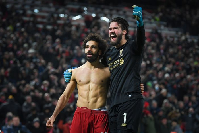 LIVERPOOL, ENGLAND - JANUARY 19: Mohamed Salah of Liverpool celebrates his goal to make it 2-0 with Alisson Becker during the Premier League match between Liverpool FC and Manchester United at Anfield on January 19, 2020 in Liverpool, United Kingdom. (Photo by Michael Regan/Getty Images)