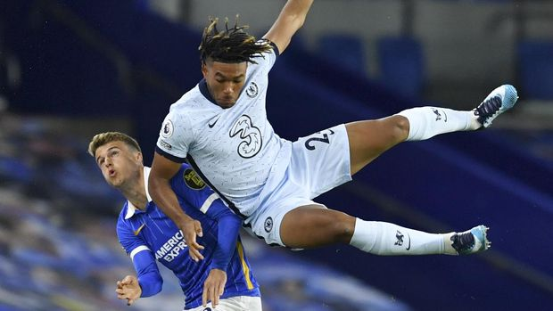 Chelsea's Reece James, right, and Brighton's Solly March contest for the ball during the English Premier League soccer match between Brighton and Chelsea at Falmer Stadium in Brighton, England, Monday, Sept. 14, 2020. (Glynn Kirk/Pool via AP)