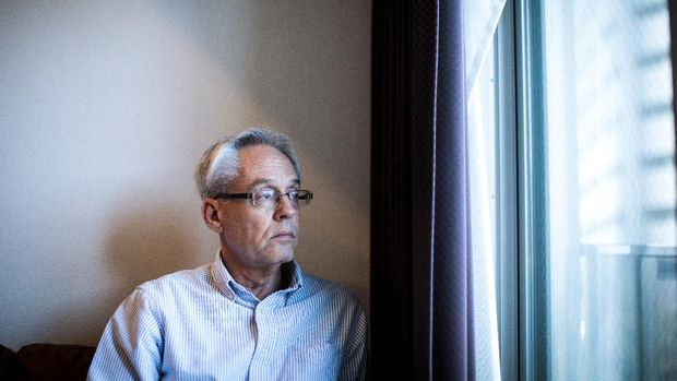 In this picture taken on February 6, 2020 former Nissan executive Greg Kelly, who is charged with financial misconduct, poses at his apartment in Tokyo. - Kelly, a former associate of Carlos Ghosn, has told AFP he was