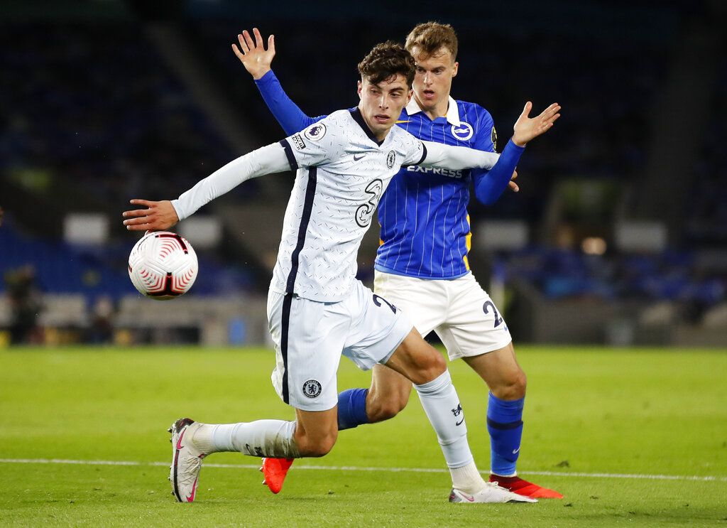Chelsea's Kai Havertz, left, and Brighton's Solly March battle for the ball during the English Premier League soccer match between Brighton and Chelsea at Falmer Stadium in Brighton, England, Monday, Sept. 14, 2020. (Peter Cziborra/Pool via AP)