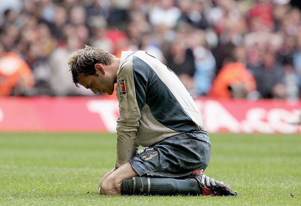 CARDIFF, UNITED KINGDOM - MAY 21:  Goal keeper, Roy Carroll of Manchester United is dejected after losing the FA Cup Final between Arsenal and Manchester United 5-4 on penalties at The Millennium Stadium on May 21, 2005 in Cardiff, Wales.  (Photo by Phil Cole/Getty Images)