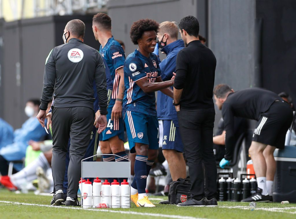 LONDON, ENGLAND - SEPTEMBER 12: Willian of Arsenal shakes hands with Mikel Arteta, Manager of Arsenal after he is subbed during the Premier League match between Fulham and Arsenal at Craven Cottage on September 12, 2020 in London, England. (Photo by Paul Childs - Pool/Getty Images)