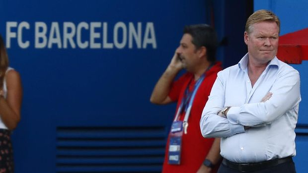 Barcelona's coach Ronald Koeman stands during the pre-season friendly soccer match between Barcelona and Girona at the Johan Cruyff Stadium in Barcelona, Spain, Wednesday, Sept. 16, 2020. (AP Photo/Joan Monfort)