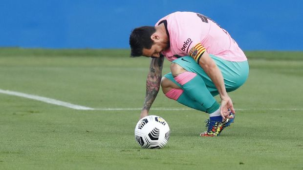Barcelona's Lionel Messi reacts during the pre-season friendly soccer match between Barcelona and Girona at the Johan Cruyff Stadium in Barcelona, Spain, Wednesday, Sept. 16, 2020. (AP Photo/Joan Monfort)