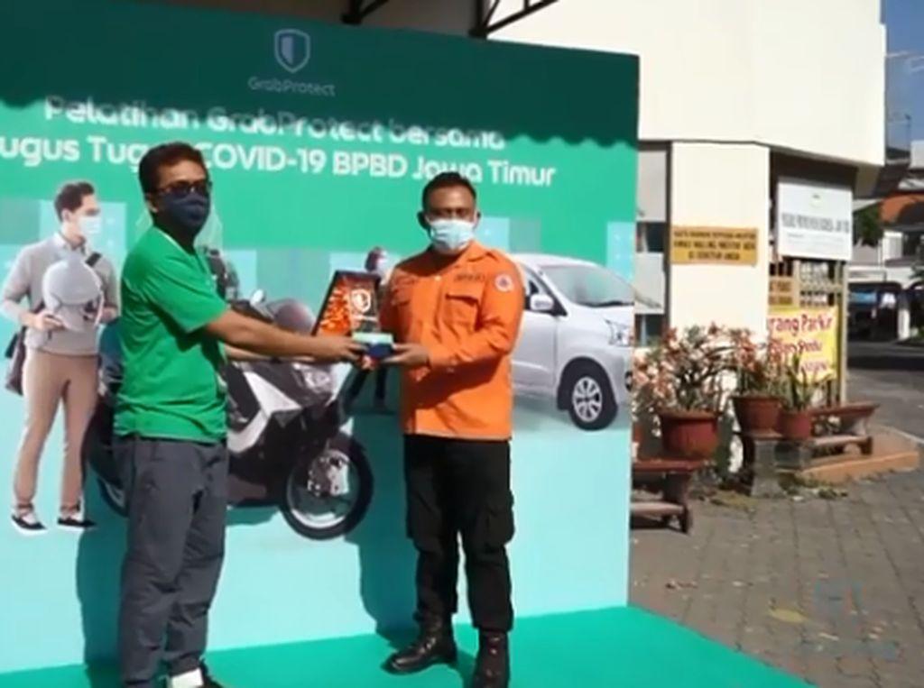 Grab Gandeng Gugus Tugas Beri Pelatihan ke Mitra Driver di Jatim