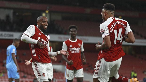Arsenal???s Alexandre Lacazette celebrates with Arsenal???s Pierre-Emerick Aubameyang after scoring the opening goal during the English Premier League soccer match between Arsenal and West Ham at the Emirates Stadium in London, England, Saturday, Sept. 19, 2020. (AP Photo/Ian Walton, Pool)