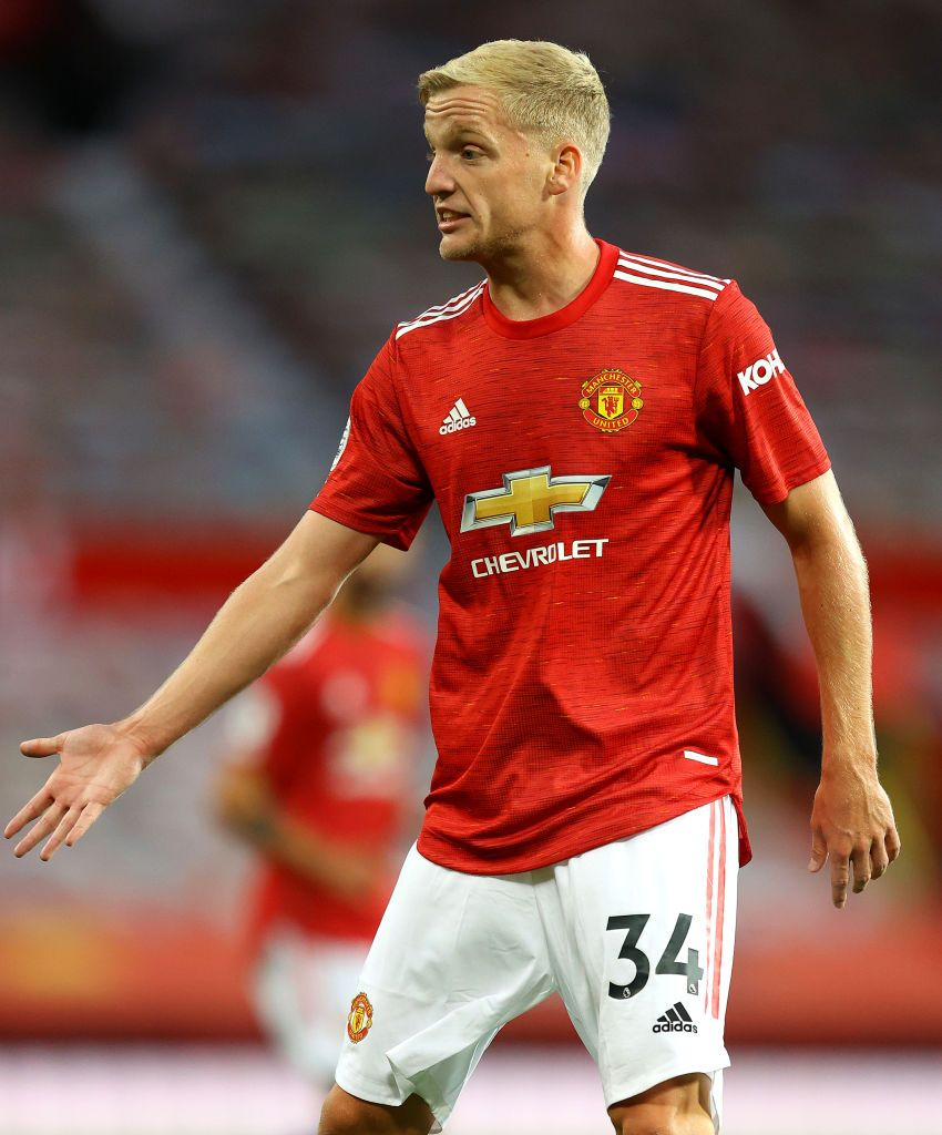 MANCHESTER, ENGLAND - SEPTEMBER 19: Donny Van De Beek of Manchester United celebrates after scoring his team's first goal  during the Premier League match between Manchester United and Crystal Palace at Old Trafford on September 19, 2020 in Manchester, England. (Photo by Martin Rickett - Pool/Getty Images)