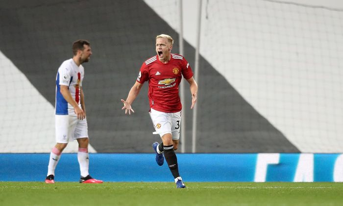 MANCHESTER, ENGLAND - SEPTEMBER 19: Donny Van De Beek of Manchester United celebrates after scoring his teams first goal  during the Premier League match between Manchester United and Crystal Palace at Old Trafford on September 19, 2020 in Manchester, England. (Photo by Martin Rickett - Pool/Getty Images)