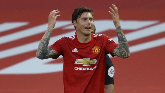 Manchester Uniteds Victor Lindelof reacts after a penalty is awarded to Crystal Palace upon VAR review during the English Premier League soccer match between Manchester United and Crystal Palace at the Old Trafford stadium in Manchester, England, Saturday, Sept. 19, 2020. (Richard Heathcote/Pool via AP)
