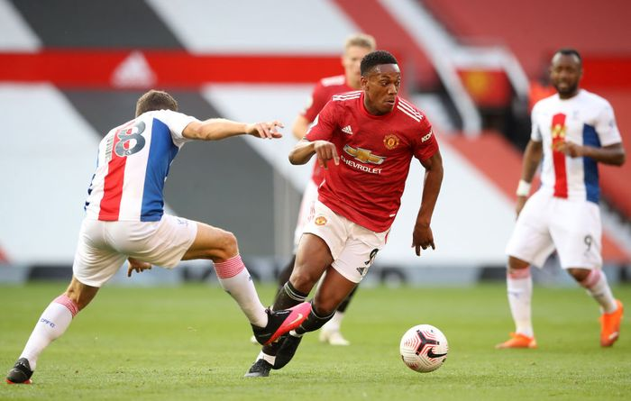 MANCHESTER, ENGLAND - SEPTEMBER 19: Anthony Martial of Manchester United takes on James McArthur of Crystal Palace during the Premier League match between Manchester United and Crystal Palace at Old Trafford on September 19, 2020 in Manchester, England. (Photo by Martin Rickett - Pool/Getty Images)