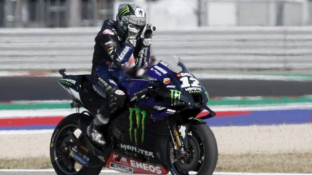 MotoGP rider Maverick Vinales of Spain reacts after winning the Emilia Romagna Motorcycle Grand Prix at the Misano circuit in Misano Adriatico, Italy, Sunday, Sept. 20, 2020. (AP Photo/Antonio Calanni)