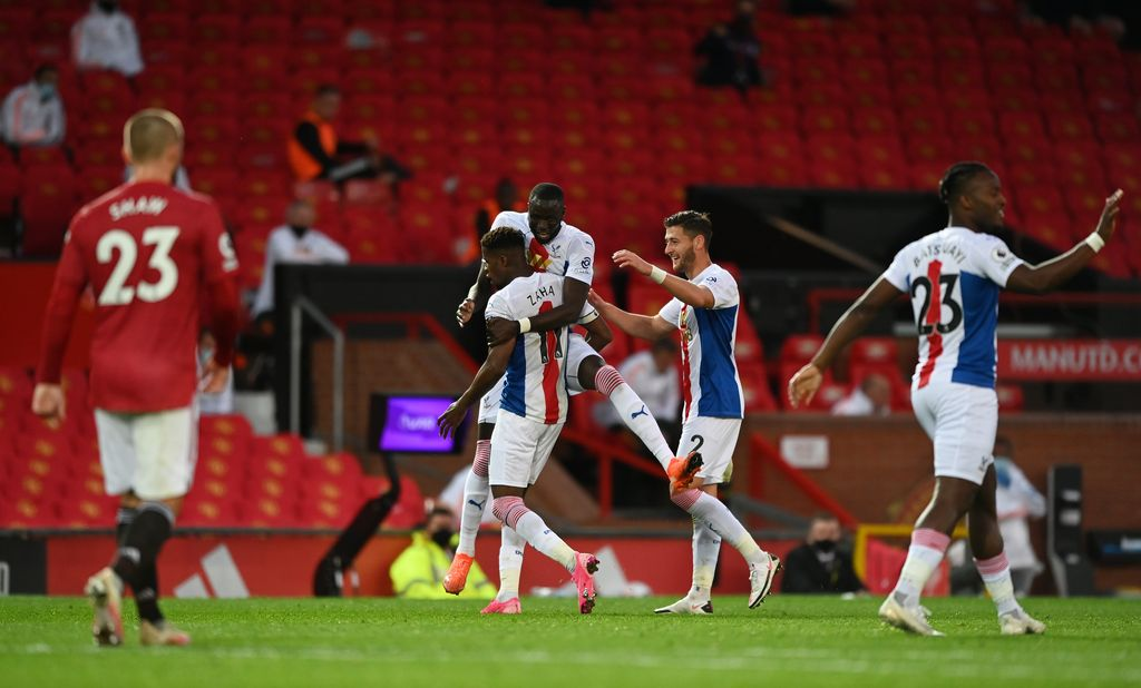 MANCHESTER, ENGLAND - SEPTEMBER 19: Wilfried Zaha of Crystal Palace celebrates with teammates after scoring his team's third goal  during the Premier League match between Manchester United and Crystal Palace at Old Trafford on September 19, 2020 in Manchester, England. (Photo by Shaun Botterill/Getty Images)