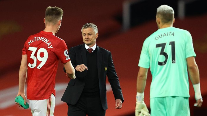 MANCHESTER, ENGLAND - SEPTEMBER 19: Ole Gunnar Solskjaer, Manager of Manchester United with Scott McTominay of Manchester United following the Premier League match between Manchester United and Crystal Palace at Old Trafford on September 19, 2020 in Manchester, England. (Photo by Richard Heathcote/Getty Images )