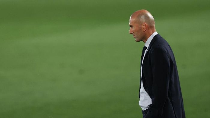 MADRID, SPAIN - JULY 02: Head coach Zinedine Zidane of Real Madrid reacts during the Liga match between Real Madrid CF and Getafe CF at Estadio Alfredo Di Stefano on July 02, 2020 in Madrid, Spain. Football Stadiums around Europe remain empty due to the Coronavirus Pandemic as Government social distancing laws prohibit fans inside venues resulting in all fixtures being played behind closed doors. (Photo by Angel Martinez/Getty Images)