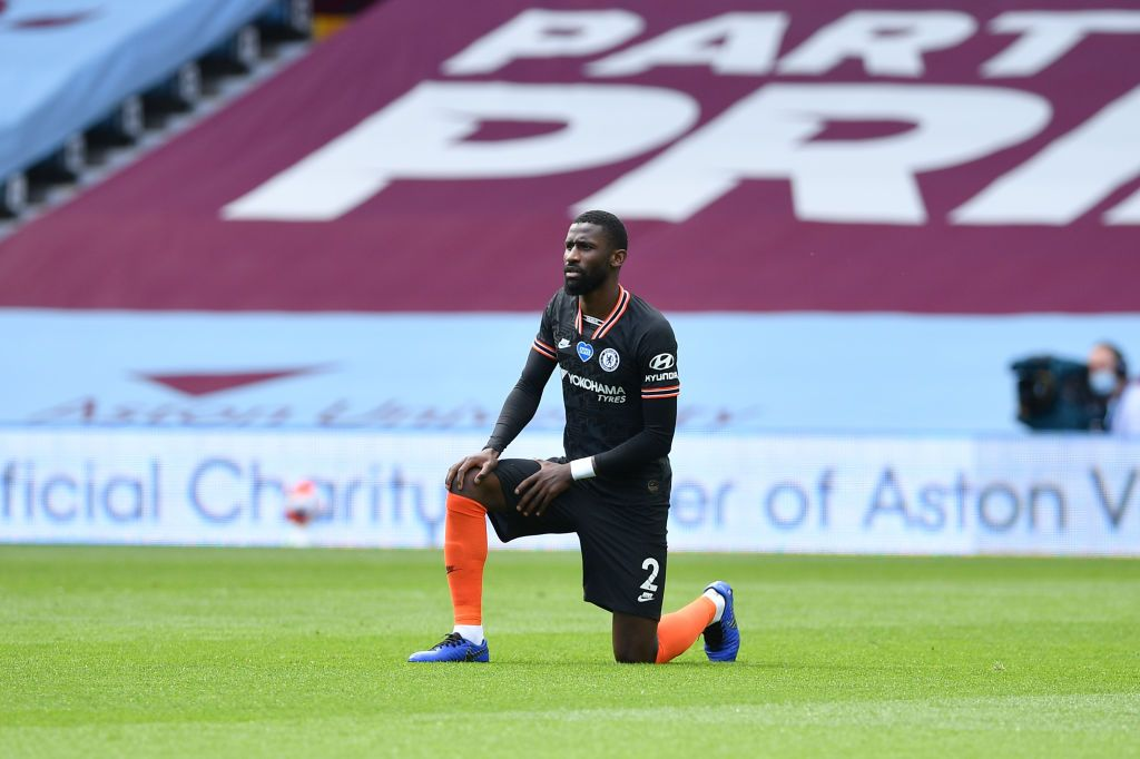 BIRMINGHAM, ENGLAND - JUNE 21: Antonio Rudiger of Chelsea takes a knee in support of the Black Lives Matter movement  during the Premier League match between Aston Villa and Chelsea FC at Villa Park on June 21, 2020 in Birmingham, England. Football Stadiums around Europe remain empty due to the Coronavirus Pandemic as Government social distancing laws prohibit fans inside venues resulting in all fixtures being played behind closed doors. (Photo by Justin Tallis/Pool via Getty Images)
