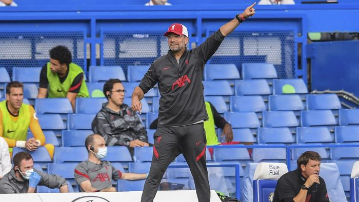 Liverpools manager Jurgen Klopp gestures during the English Premier League soccer match between Chelsea and Liverpool at Stamford Bridge Stadium, Sunday, Sept. 20, 2020. (Will Oliver/Pool via AP)