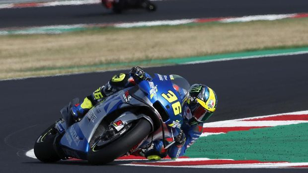 MotoGP rider Joan Mir of Spain takes a curve during the Emilia Romagna Motorcycle Grand Prix at the Misano circuit in Misano Adriatico, Italy, Sunday, Sept. 20, 2020. (AP Photo/Antonio Calanni)