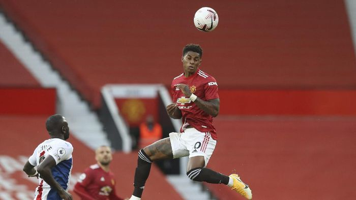 Manchester Uniteds Marcus Rashford heads the ball during the English Premier League soccer match between Manchester United and Crystal Palace at the Old Trafford stadium in Manchester, England, Saturday, Sept. 19, 2020. (Martin Rickett /Pool via AP)