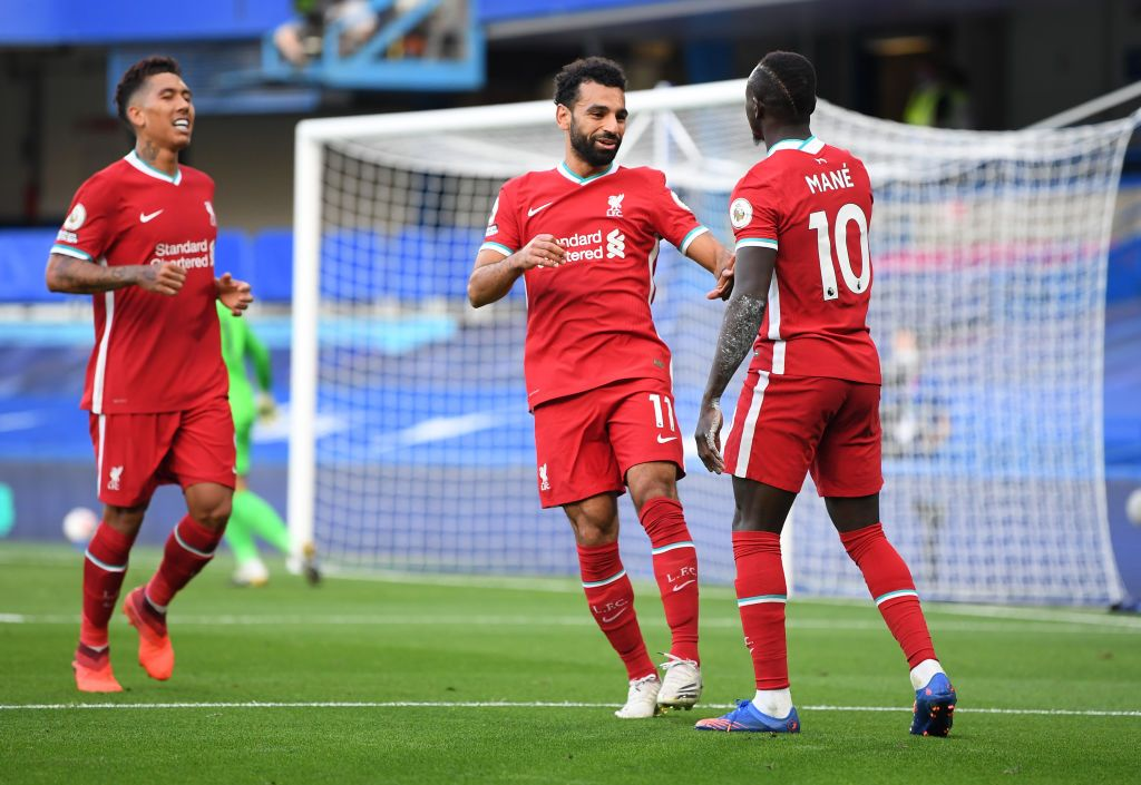 LONDON, ENGLAND - SEPTEMBER 20: Sadio Mane of Liverpool celebrates with teammate Mohamed Salah after scoring his team's second goal during the Premier League match between Chelsea and Liverpool at Stamford Bridge on September 20, 2020 in London, England. (Photo by Michael Regan/Getty Images)
