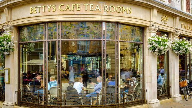York, England - July 5, 2014: Betty's Cafe Tea Rooms, busy full of customers. At 6-8 St Helen€™s Square, York, North Yorkshire.