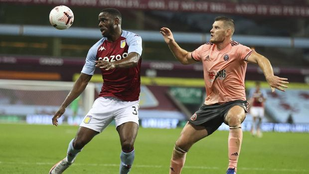 Aston Villa's Keinan Davis, left, challenges for the ball with Sheffield United's Jack O'Connell during the English Premier League soccer match between Aston Villa and Sheffield United at the Villa Park stadium in Birmingham, Monday, Sept. 21, 2020. (Julian Finney/Pool via AP)