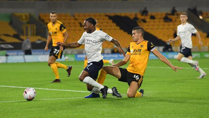 WOLVERHAMPTON, ENGLAND - SEPTEMBER 21: Conor Coady of Wolverhampton Wanderers makes a challenge on Raheem Sterling of Manchester City during the Premier League match between Wolverhampton Wanderers and Manchester City at Molineux on September 21, 2020 in Wolverhampton, England. (Photo by Stu Forster/Getty Images)