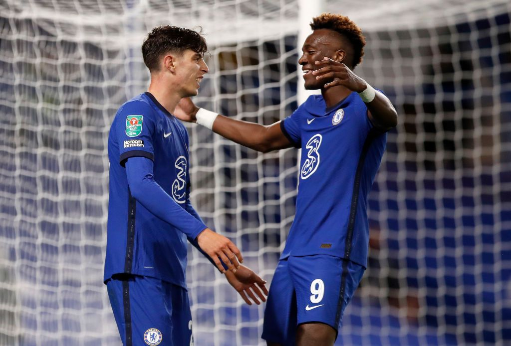 LONDON, ENGLAND - SEPTEMBER 23: Kai Havertz of Chelsea (L) celebrates after scoring his sides fifth goal with teammate Tammy Abraham during the Carabao Cup third round match between Chelsea and Barnsley at Stamford Bridge on September 23, 2020 in London, England. Football Stadiums around United Kingdom remain empty due to the Coronavirus Pandemic as Government social distancing laws prohibit fans inside venues resulting in fixtures being played behind closed doors. (Photo by Alastair Grant - Pool/Getty Images)