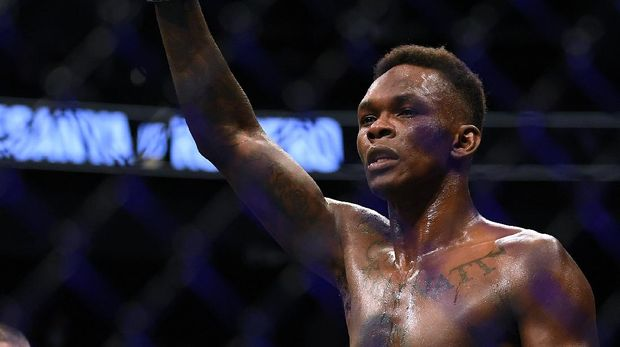 LAS VEGAS, NEVADA - MARCH 07: Israel Adesanya celebrates a decision win over Yoel Romero during a middleweight title bout at T-Mobile Arena on March 07, 2020 in Las Vegas, Nevada.   Harry How/Getty Images/AFP