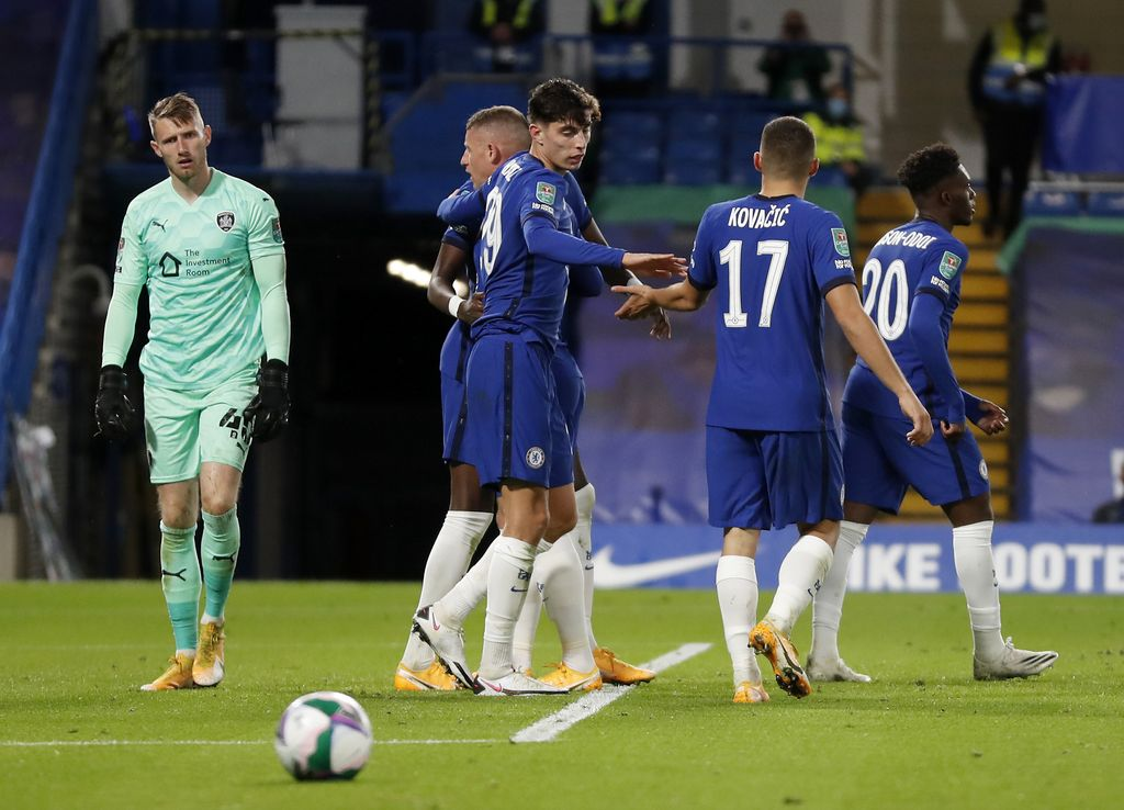 LONDON, ENGLAND - SEPTEMBER 23: Kai Havertz of Chelsea (C) celebrates after scoring his sides fourth goal with teammate Mateo Kovacic during the Carabao Cup third round match between Chelsea and Barnsley at Stamford Bridge on September 23, 2020 in London, England. Football Stadiums around United Kingdom remain empty due to the Coronavirus Pandemic as Government social distancing laws prohibit fans inside venues resulting in fixtures being played behind closed doors. (Photo by Alastair Grant - Pool/Getty Images)