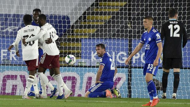 Leicester's Christian Fuchs, center, reacts after scoring an own goal during the English League Cup 3rd round soccer match between Leicester City and Arsenal at the King Power Stadium in Leicester, England, Wednesday, Sept. 23, 2020. (AP Photo/Rui Vieira, Pool)