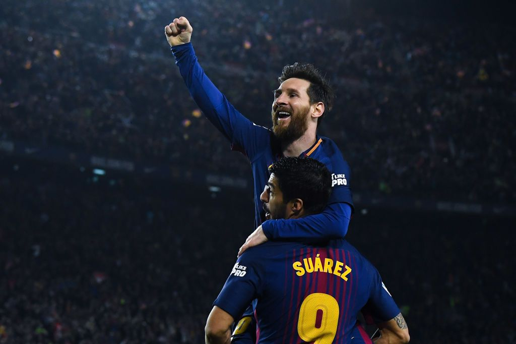 BARCELONA, SPAIN - MAY 06:  Lionel Messi of FC Barcelona celebrates with his team mate Luis Suarez after scoring his team's second goal during the La Liga match between Barcelona and Real Madrid at Camp Nou on May 6, 2018 in Barcelona, Spain.  (Photo by David Ramos/Getty Images)