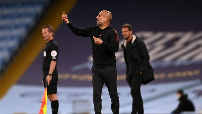 MANCHESTER, ENGLAND - SEPTEMBER 24: Pep Guardiola, Manager of Manchester City gives his team instructions during the Carabao Cup third round match between Manchester City and AFC Bournemouth at Etihad Stadium on September 24, 2020 in Manchester, England. Football Stadiums around Europe remain empty due to the Coronavirus Pandemic as Government social distancing laws prohibit fans inside venues resulting in fixtures being played behind closed doors. (Photo by Laurence Griffiths/Getty Images)