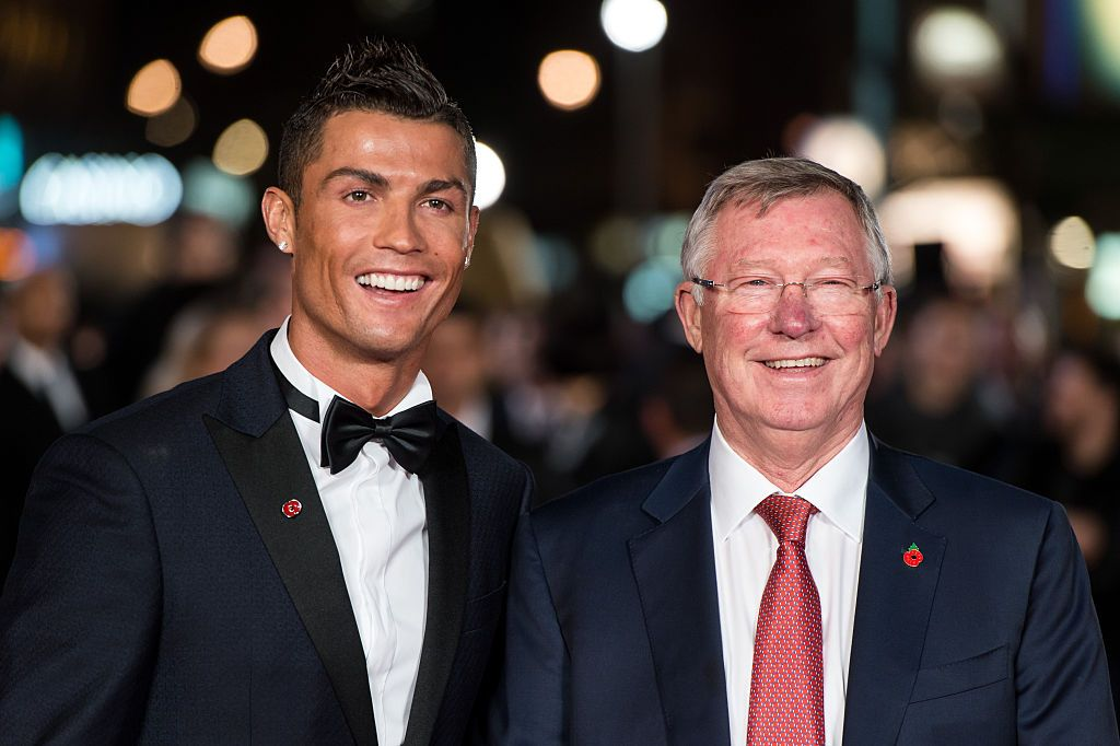 MANCHESTER, UNITED KINGDOM - DECEMBER 05:  Sir Alex Ferguson the manager of Manchester United talks with Cristiano Ronaldo during the Manchester United training session at the Carrington Training Complex on December 5, 2006 at Carrington in Manchester, England.  (Photo by Alex Livesey/Getty Images)