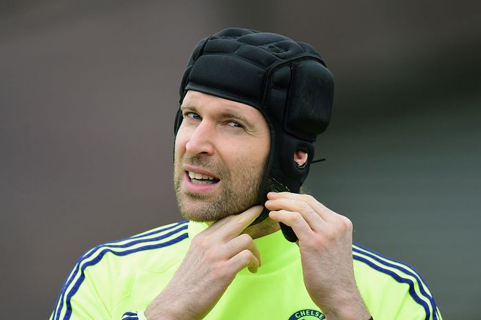 LONDON, ENGLAND - FEBRUARY 16:  Goalkeeper Petr Cech of Chelsea adjusts his protective head gear during a Chelsea training session ahead of the UEFA Champions League round of 16 match against Paris Saint-Germain at Cobham Training Centre on February 16, 2015 in London, United Kingdom.  (Photo by Jamie McDonald/Getty Images)