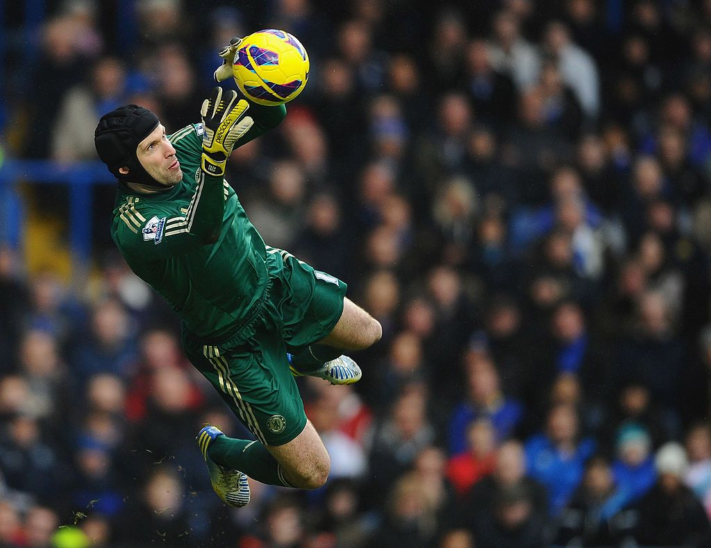 LONDON, ENGLAND - FEBRUARY 09:  Petr Cech of Chelsea dives to make a save during the Barclays Premier League match between Chelsea and Wigan Athletic at Stamford Bridge on February 9, 2013 in London, England.  (Photo by Laurence Griffiths/Getty Images)