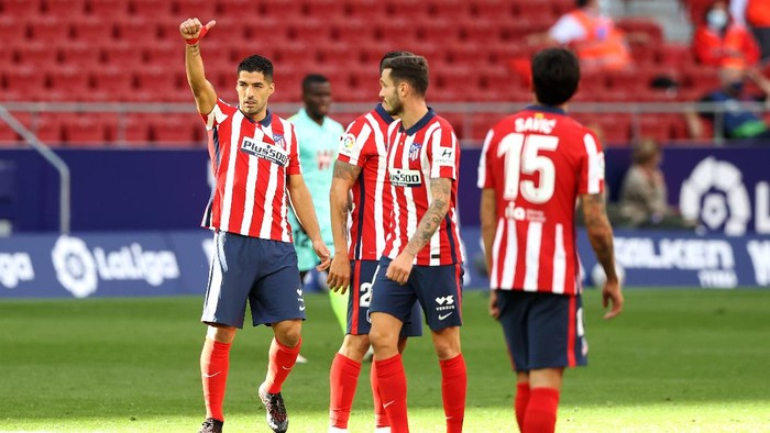 MADRID, SPAIN - SEPTEMBER 27: Luis Suarez of Atletico de Madrid celebrates after scoring his sides fifth goal during the La Liga Santander match between Atletico de Madrid and Granada CF at Estadio Wanda Metropolitano on September 27, 2020 in Madrid, Spain. Football Stadiums around Europe remain empty due to the Coronavirus Pandemic as Government social distancing laws prohibit fans inside venues resulting in fixtures being played behind closed doors. (Photo by Angel Martinez/Getty Images)