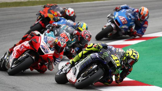 MotoGP rider Valentino Rossi of Italy takes a curve followed by Jack Miller of Australia, left, during the Catalunya Motorcycle Grand Prix at the Barcelona Catalunya racetrack in Montmelo, near Barcelona, Spain, Sunday, Sept. 27, 2020. (AP Photo/Joan Monfort)