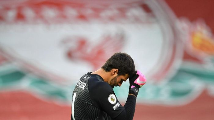 LIVERPOOL, ENGLAND - SEPTEMBER 12: Alisson Becker of Liverpool looks dejected after conceding a third goal during the Premier League match between Liverpool and Leeds United at Anfield on September 12, 2020 in Liverpool, England. (Photo by Paul Ellis - Pool/Getty Images)