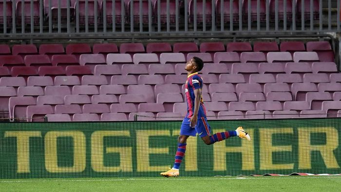 BARCELONA, SPAIN - SEPTEMBER 27: Ansu Fati of FC Barcelona celebrates after scoring his sides second goal during the La Liga Santander match between FC Barcelona and Villarreal CF at Camp Nou on September 27, 2020 in Barcelona, Spain. Football Stadiums around Europe remain empty due to the Coronavirus Pandemic as Government social distancing laws prohibit fans inside venues resulting in fixtures being played behind closed doors. (Photo by David Ramos/Getty Images)