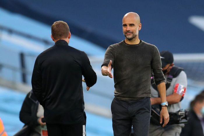 MANCHESTER, ENGLAND - SEPTEMBER 27: Pep Guardiola, Manager of Manchester City interacts with Brendan Rogers, Manager of Leicester City following the Premier League match between Manchester City and Leicester City at Etihad Stadium on September 27, 2020 in Manchester, England. Sporting stadiums around the UK remain under strict restrictions due to the Coronavirus Pandemic as Government social distancing laws prohibit fans inside venues resulting in games being played behind closed doors. (Photo by Catherine Ivill/Getty Images)
