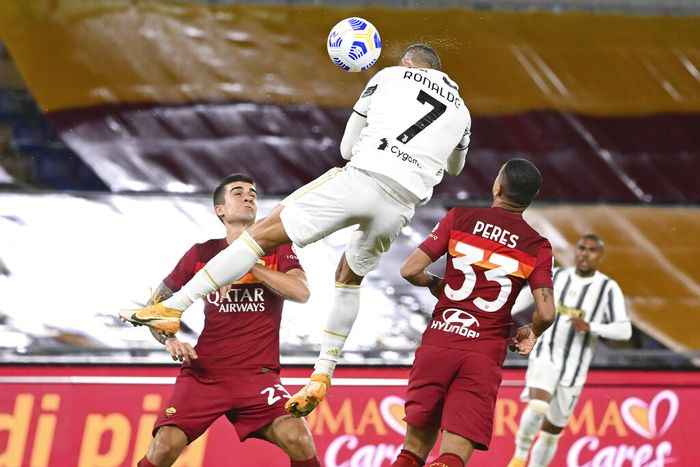 Juventus Cristiano Ronaldo, center, jumps for the ball to score during the Italian Serie A soccer match between Roma and Juventus at Romes Olympic stadium, Sunday, Sept. 27, 2020. (Fabio Rossi/LaPresse via AP)